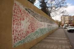 Flagge Jordaniens bestehend aus Kinderhänden